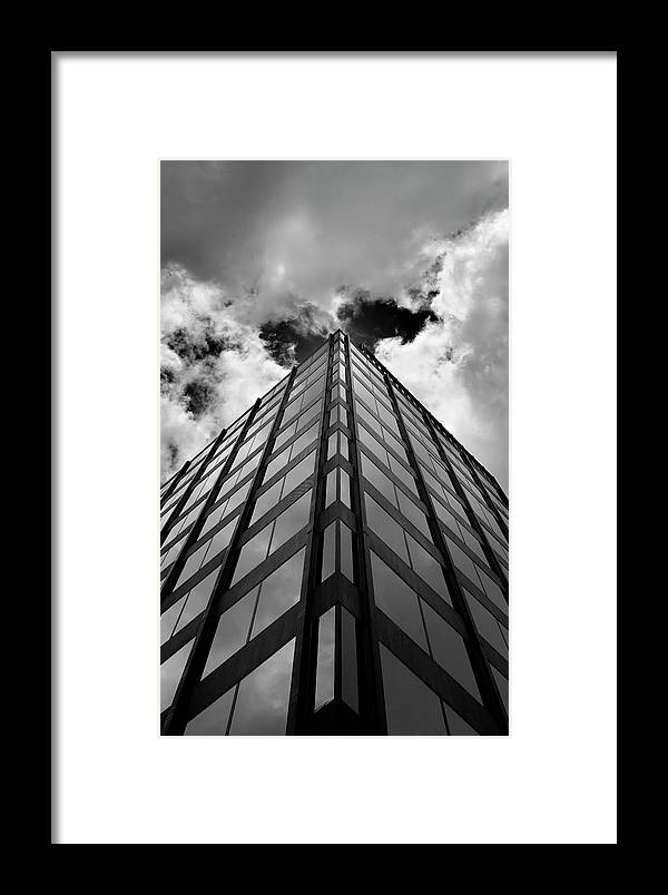 Clouds Framed Print featuring the photograph Clouds And Office Building Midtown by Robert Ullmann