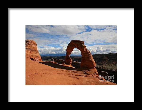 Delicate Arch Framed Print featuring the photograph Delicate Arch by Timothy Johnson