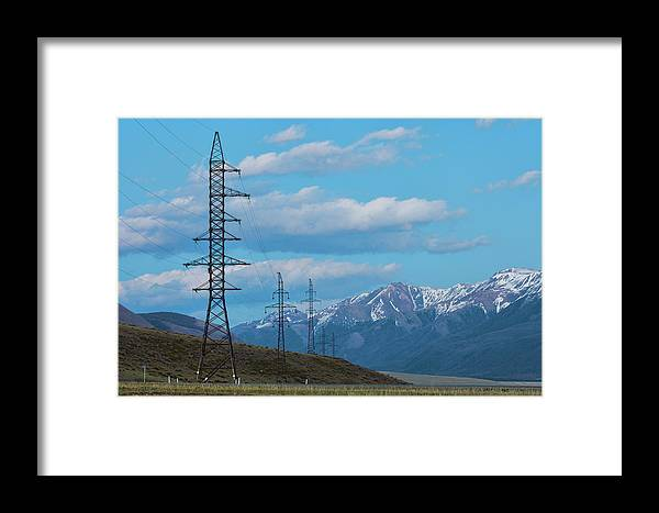 Air Framed Print featuring the photograph Electric Power Transmission Pylons On Inner Mongolia Grassland At Sunrise by Oleg Yermolov