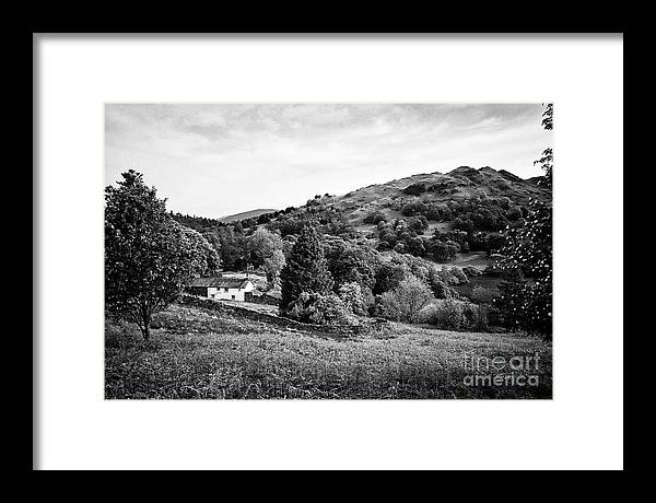 Farm Framed Print featuring the photograph Farmhouse And Surrounding Countryside At Loughrigg Fell And Loughrigg Tarn Near Ambleside Lake Distr by Joe Fox