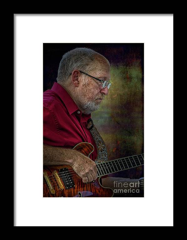 Xdop Framed Print featuring the photograph Guitar Picker In The Park On Sunday by John Herzog