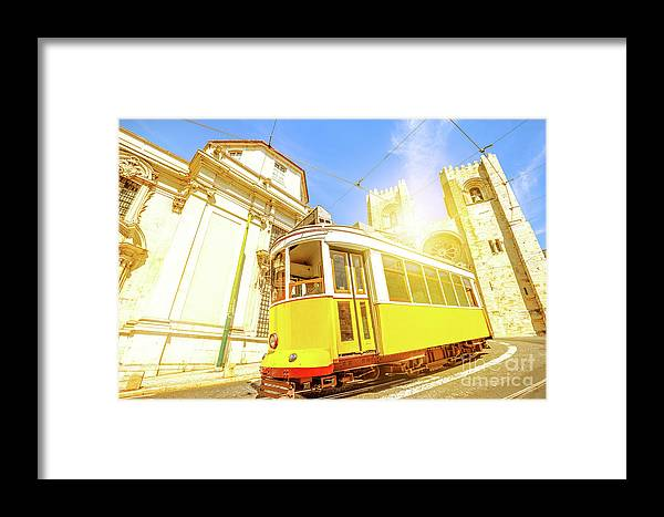 Lisbon Framed Print featuring the photograph Historic Tram And Lisbon Cathedral by Benny Marty
