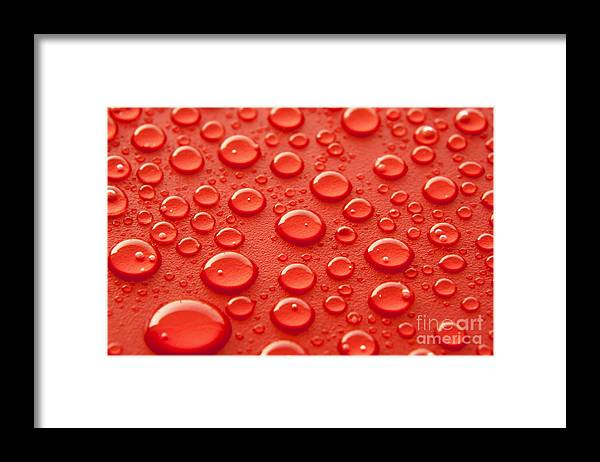 Water Framed Print featuring the photograph Red water drops by Blink Images