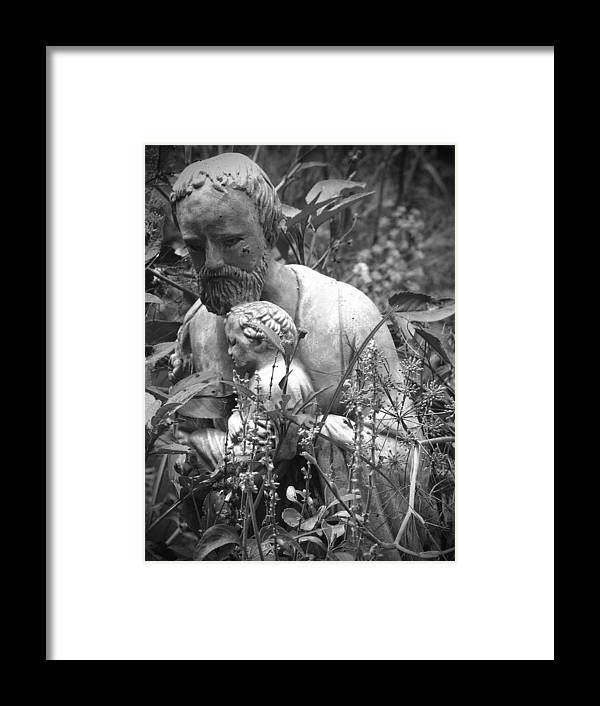 Religious Framed Print featuring the photograph Statue In Flowers by Megan Verzoni