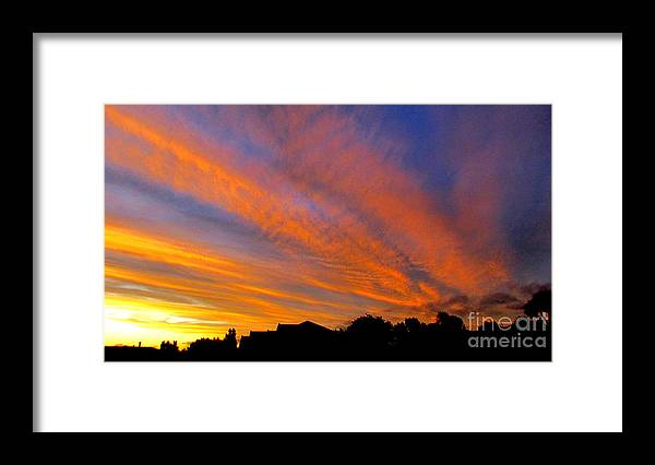 Sunset. Framed Print featuring the photograph Sunset through the clouds by Joyce Woodhouse