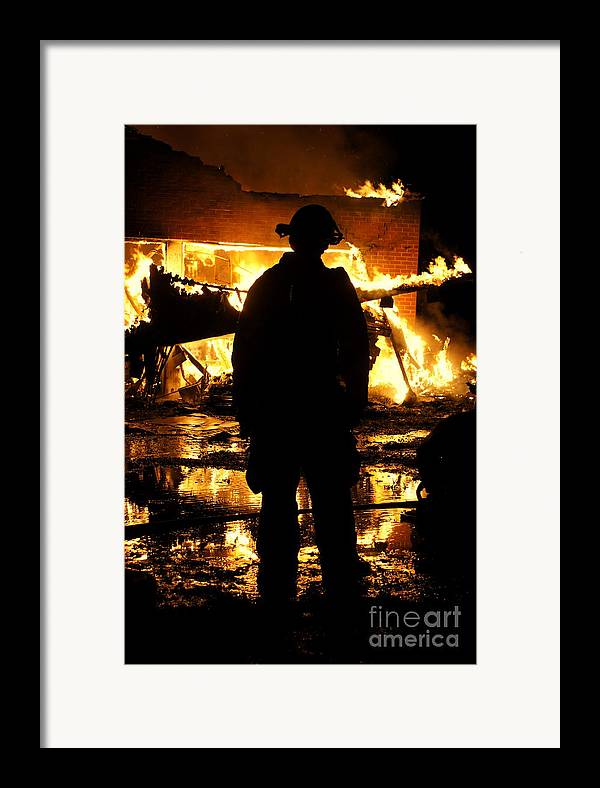 Fireman Framed Print featuring the photograph The Fireman by Benanne Stiens