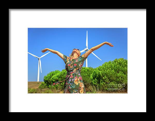 Wind Turbines Framed Print featuring the photograph Wind Turbines Woman by Benny Marty