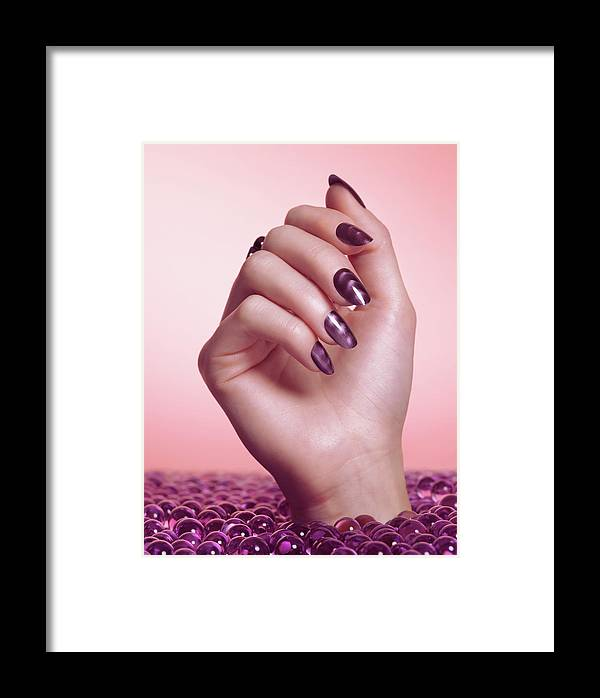 Manicure Framed Print featuring the photograph Woman Hand With Purple Nail Polish by Oleksiy Maksymenko