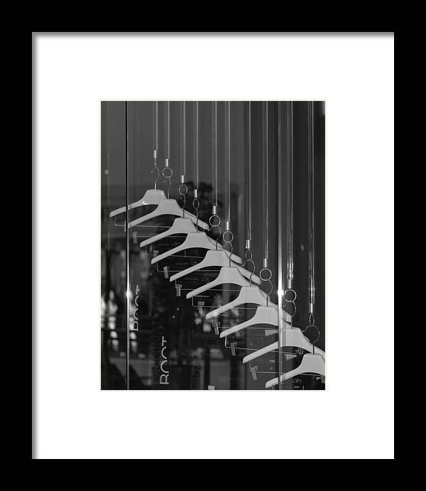 Hangers Framed Print featuring the photograph 10 Hangers In Black And White by Rob Hans
