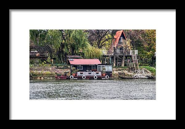 Raft Framed Print featuring the photograph A Raft House Moored To The Shoreline Of Ada Medjica Islet by Bratislav Stefanovic