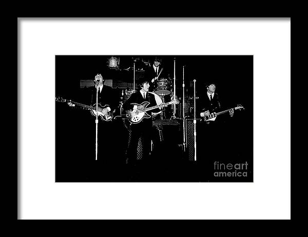 Beatles Framed Print featuring the photograph Beatles In Concert 1964 by Larry Mulvehill