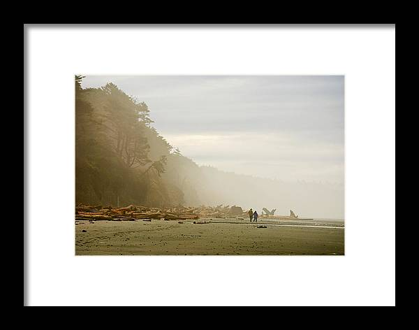 Washington State Olympic Peninsula Pacific Ocean Kalaloch Beach Beaches Seascape Seascapes Solitude Fog Foggy Couple Sand Water Driftwood Framed Print featuring the photograph Couple On A Foggy Beach by Wilbur Young