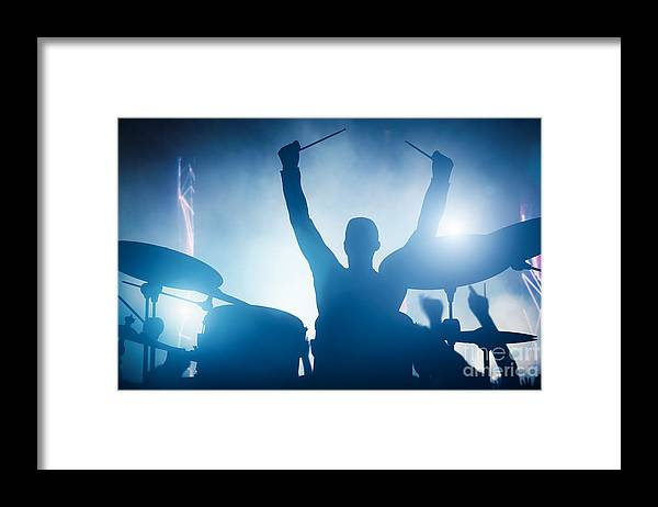 Drums Framed Print featuring the photograph Drummer playing on drums on music concert. Club lights by Michal Bednarek