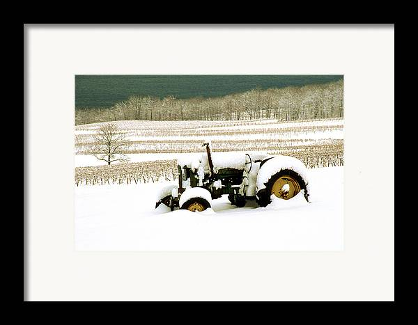 Framed Print featuring the photograph Tractor In Snowy Vineyard by Roger Soule