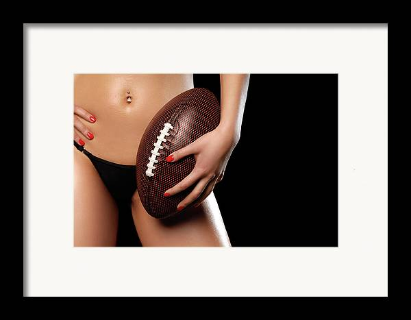 Football Framed Print featuring the photograph Woman With A Football by Oleksiy Maksymenko