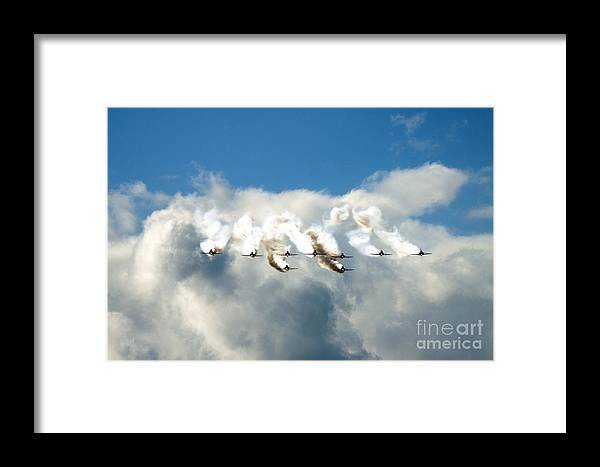 Red Arrows Framed Print featuring the photograph Red Arrows by Angel Ciesniarska