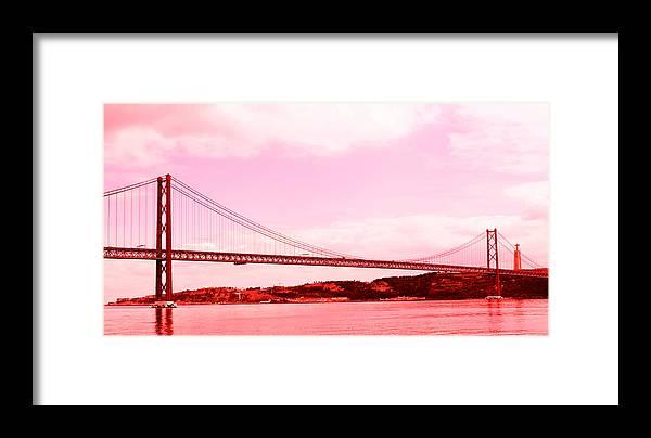 Lisbon Framed Print featuring the photograph 25 De Abril Bridge In Crimson by Lorraine Devon Wilke