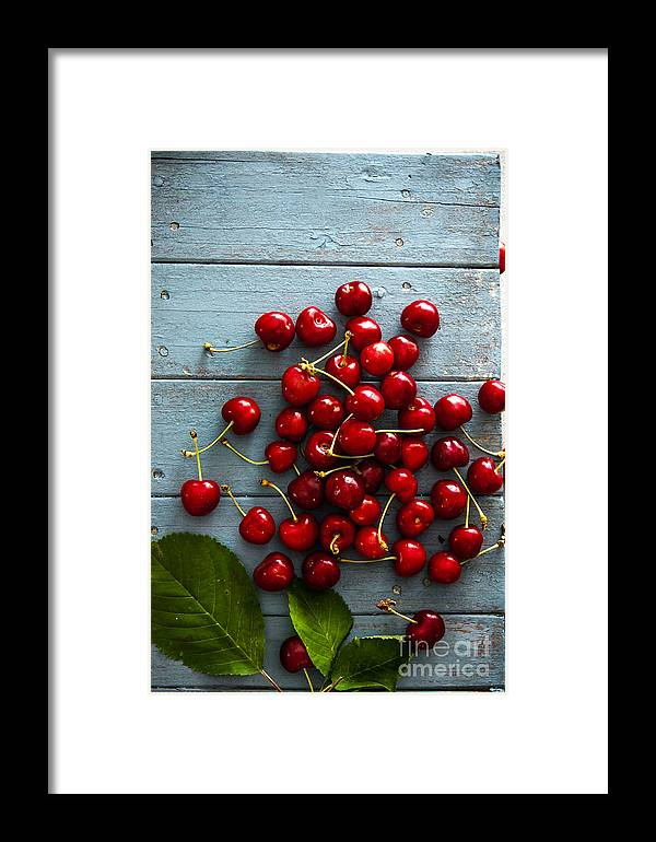 Juicy Framed Print featuring the photograph Fresh Cherries On Wood by Mythja Photography