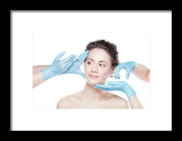 Aesthetic Framed Print featuring the photograph Young Woman Having Botox Face Injections. by Michal Bednarek
