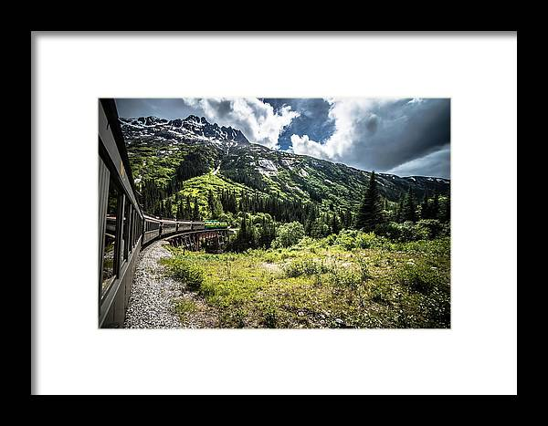 Road Framed Print featuring the photograph The White Pass And Yukon Route On Train Passing Through Vast Lan by Alex Grichenko