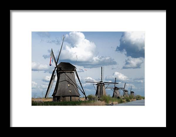 Kinderdijk Framed Print featuring the photograph Kinderdijk Windmills by Soon Ming Tsang