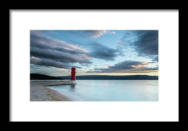 Island Framed Print featuring the photograph Red Lighthouse Of Cres On A Cloudy Day In Spring by Stefan Rotter