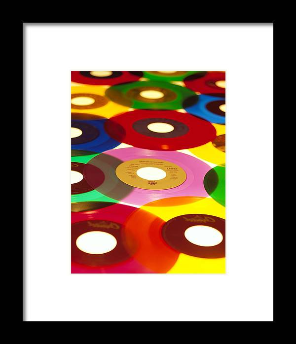 45 Framed Print featuring the photograph 45 Rpm by Robert Ponzoni