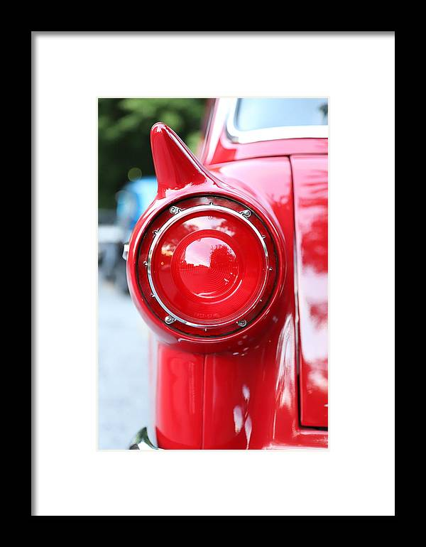 Ford Framed Print featuring the photograph '57 Tail Light by Charles van Wagenen Jr