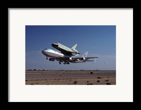 Space Framed Print featuring the photograph 747 Takes Off With Space Shuttle Enterprise For Alt-1 by Brian Lockett
