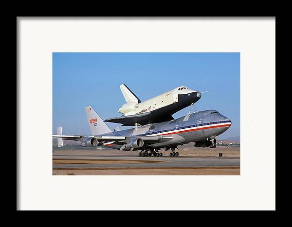 Space Framed Print featuring the photograph 747 Takes Off With Space Shuttle Enterprise For Alt-4 by Brian Lockett