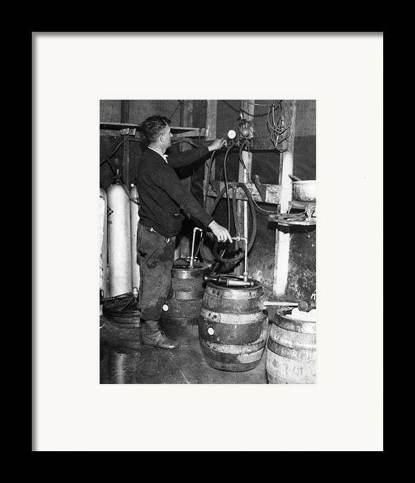 1930s Framed Print featuring the photograph A Brewmeister Fills Kegs At A Bootleg by Everett