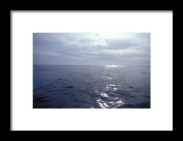 Calm Ocean Framed Print featuring the photograph A Calm Ocean With Small Ripples by Jason Edwards