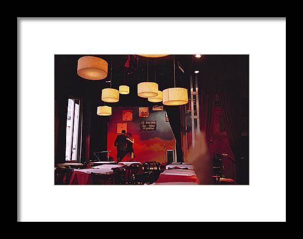 Color Image Framed Print featuring the photograph A Couple Dances The Tango At A Club by Pablo Corral Vega