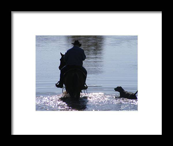Cowboy Framed Print featuring the photograph A Cowboy And His Dog by Kirstine Hidalgo