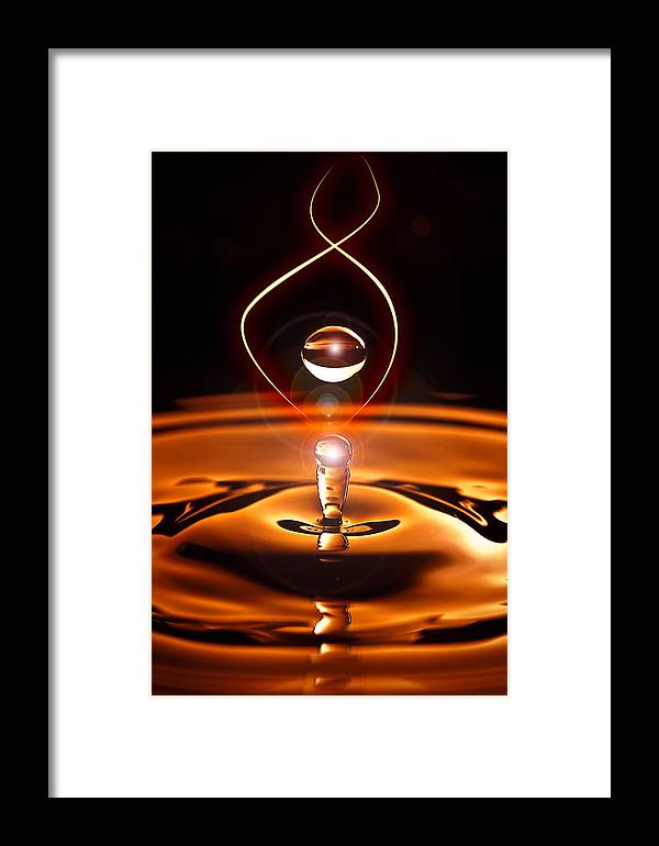 Water Drop Droplet Droplets Blue Orange Framed Print featuring the photograph A Drop Of Light by Keith Allen