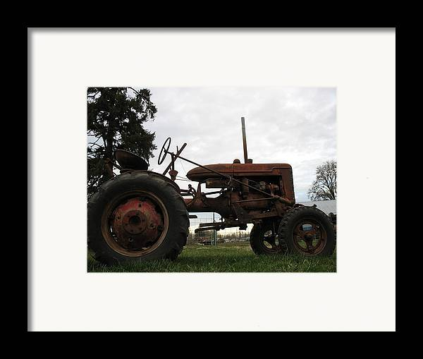 Tractor Framed Print featuring the photograph A Farmall by Juli House