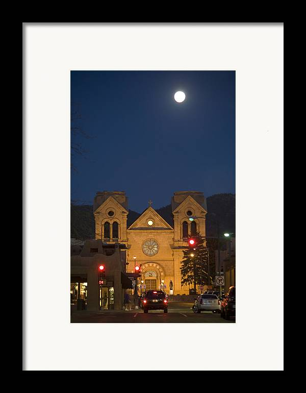 New Mexico Framed Print featuring the photograph A Full Moon Rises Over Cathedral by Stephen St. John
