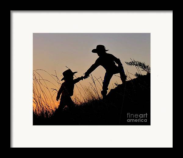 Cowboy Framed Print featuring the photograph A Helping Hand by Carla Froshaug
