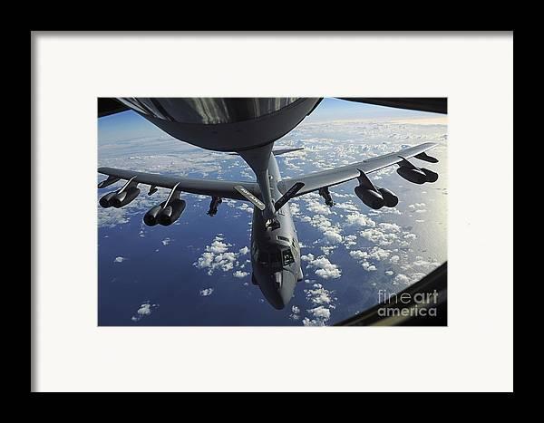 Refuel Framed Print featuring the photograph A Kc-135 Stratotanker Aircraft Refuels by Stocktrek Images