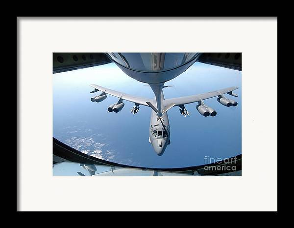 Color Image Framed Print featuring the photograph A Kc-135 Stratotanker Refuels A B-52 by Stocktrek Images
