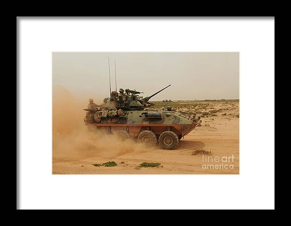 Dust Framed Print featuring the photograph A Marine Corps Light Armored Vehicle by Stocktrek Images