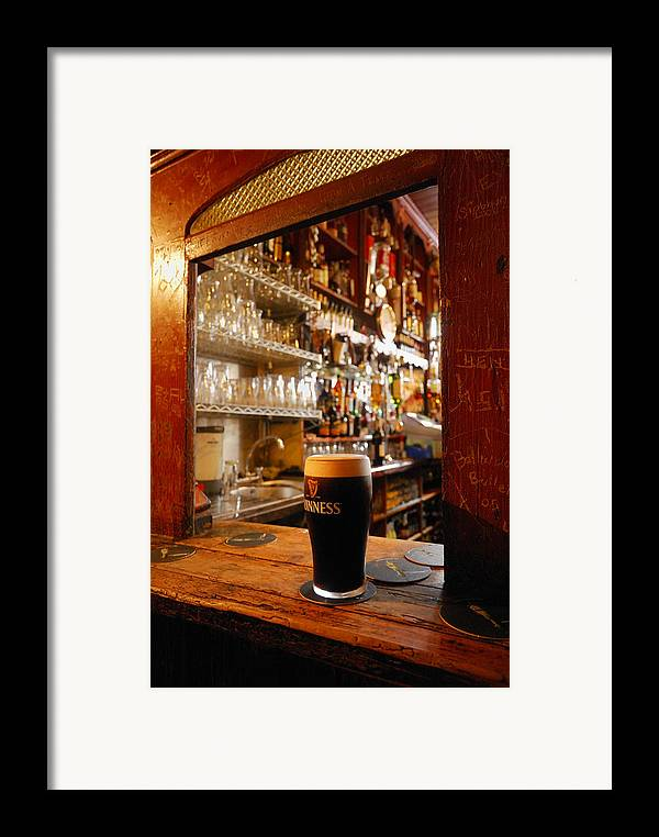 Day Framed Print featuring the photograph A Pint Of Dark Beer Sits In A Pub by Jim Richardson
