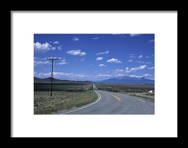 Colorado Framed Print featuring the photograph A Road Disappears Into The Distance by Taylor S. Kennedy