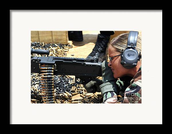 Color Image Framed Print featuring the photograph A Soldier Fires An M240b Medium Machine by Stocktrek Images