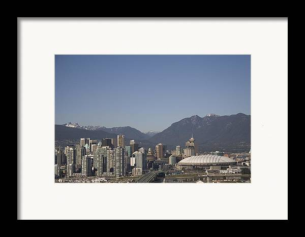 Scenes And Views Framed Print featuring the photograph A View Of The Skyline Of Vancouver, Bc by Taylor S. Kennedy