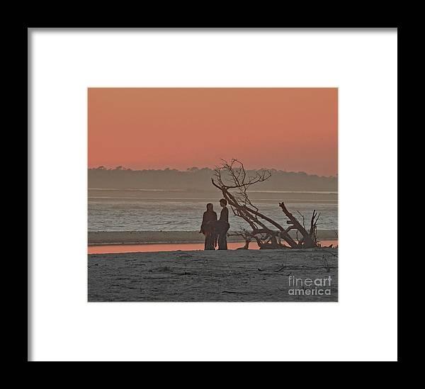 Beach Framed Print featuring the photograph A Walk At Sunset by Pam Schmitt