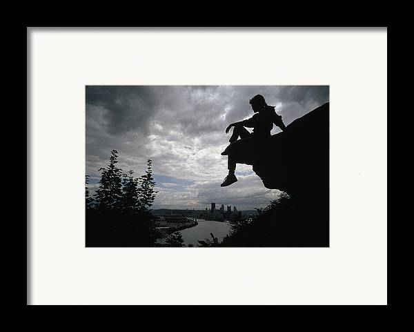 Outdoors Framed Print featuring the photograph A Woman Perched On An Overlook by Lynn Johnson