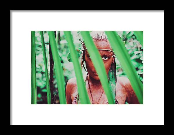 Amazon Framed Print featuring the photograph Amazonian Goddess Portrait Of A Wild Looking, Camouflaged Warrior Girl Holding Bow And Arrow by Srdjan Kirtic