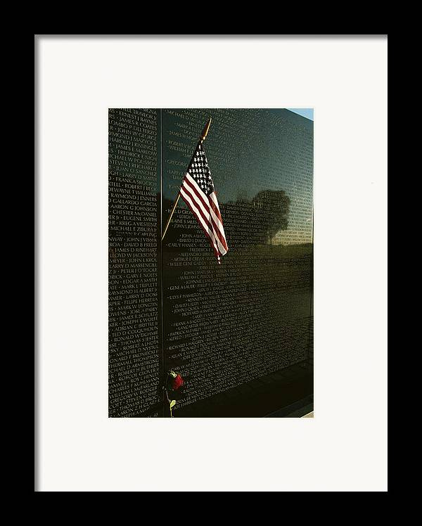 american National Flag Framed Print featuring the photograph American Flag Left At The Vietnam by Medford Taylor