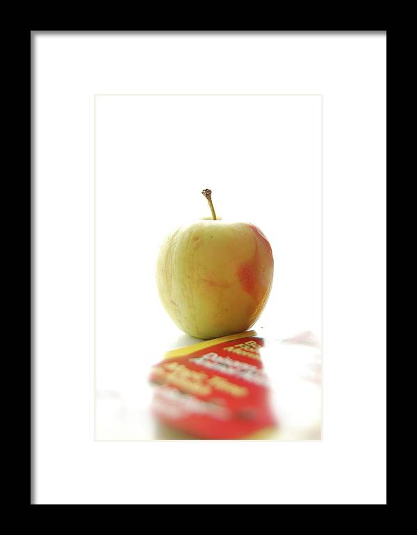 Apple Framed Print featuring the photograph An Apple A Day by Marcus L Wise